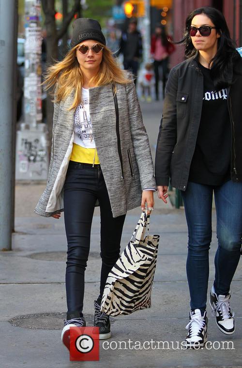Cara Delevingne looking stylish as she walks in Soho