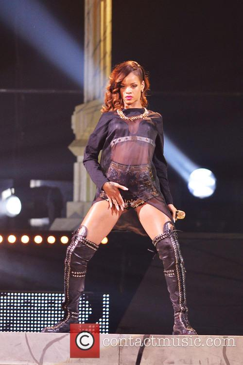 Rihanna performs during her '2013 Diamonds World Tour'...