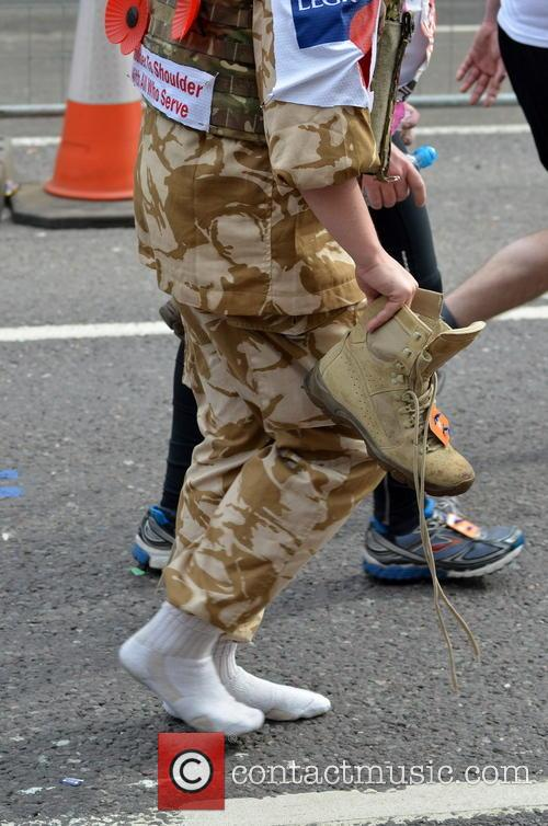 A Runner Walking With Their Shoes Off 1