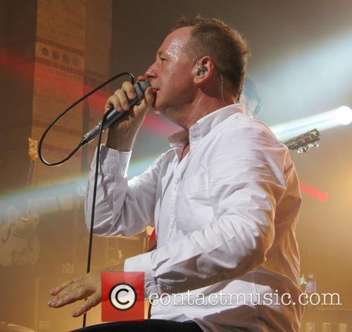 jim kerr simple minds performing on their 3623489