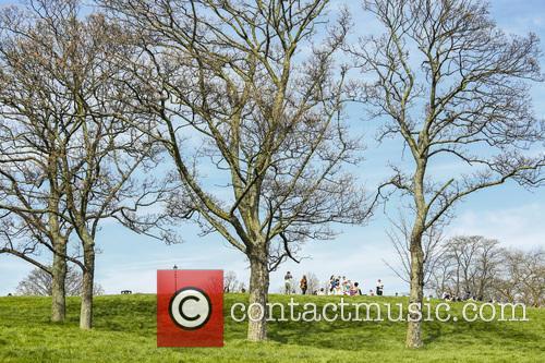 People enjoying the sunshine on Primrose Hill