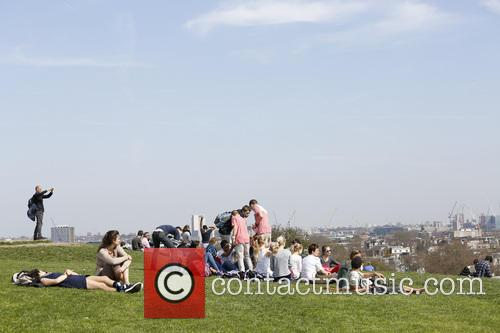 People enjoying the sunshine on Primrose Hill