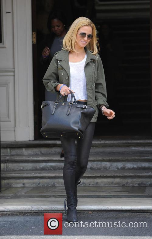 Sarah Harding leaving an address