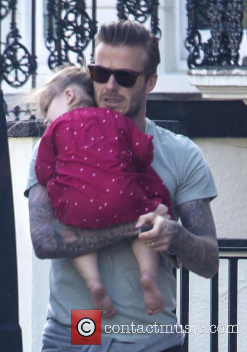 David Beckham and his daughter Harper in central...