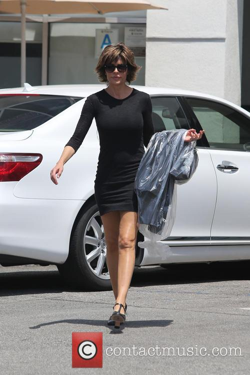 Lisa Rinna is seen getting her dry cleaning...