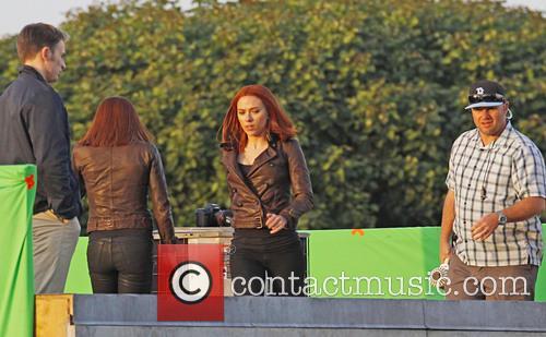 Scarlett Johansson and Chris Evans filming scenes for...