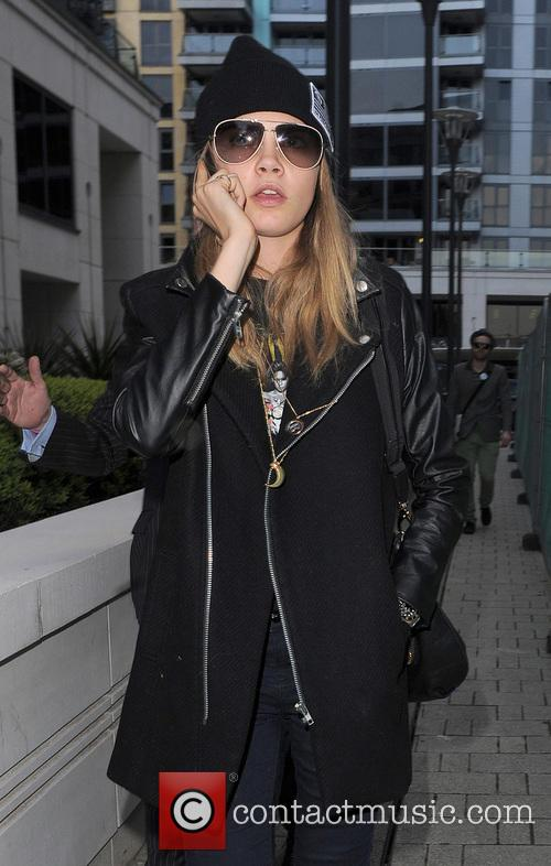 Cara Delevingne arrives at a friends house