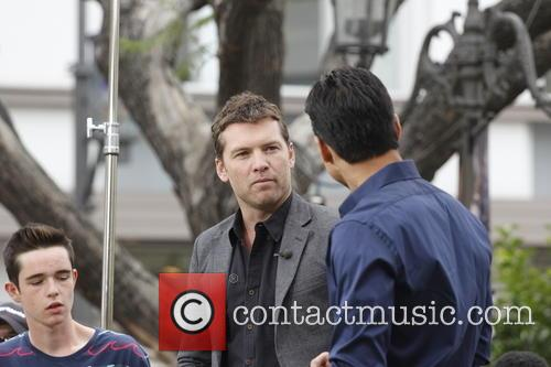Sam Worthington and Mario Lopez 11