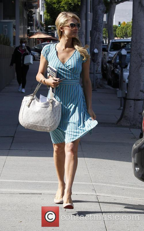 Paris Hilton arriving at a office in Beverly hills.