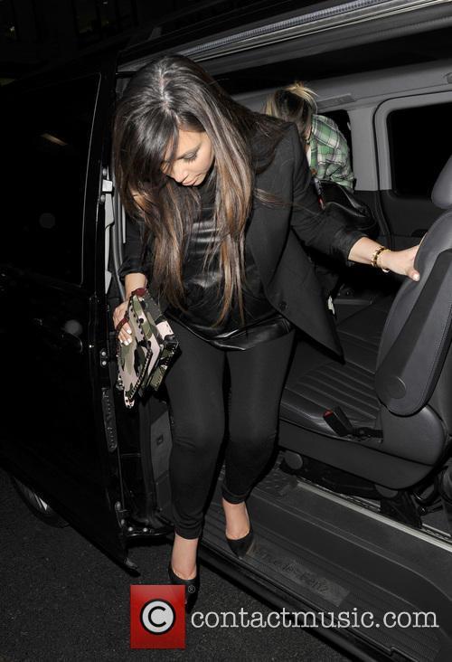 Kim Kardashian arriving at her hotel