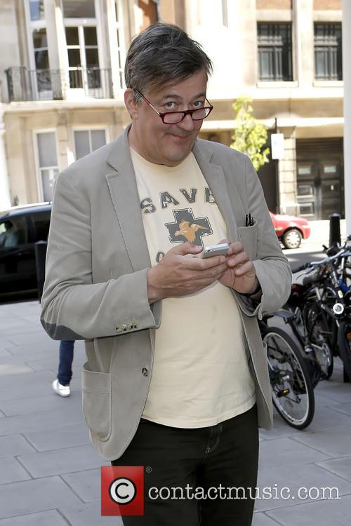 Stephen Fry in good spirits as he texts...