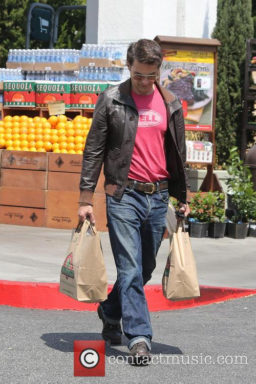 Olivier Martinez is seen pickup up groceries at...