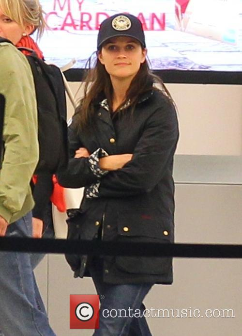 Reese Witherspoon, wearing a hat that reads 'City of Atlanta Police' arrives at LAX