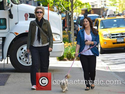 Jane Lynch and her wife Lara Embry walk...