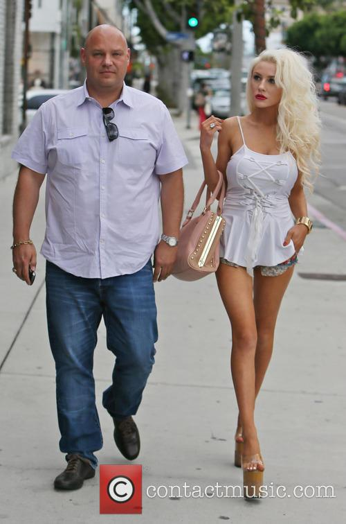 Courtney Stodden walking with a friend on Robertson...