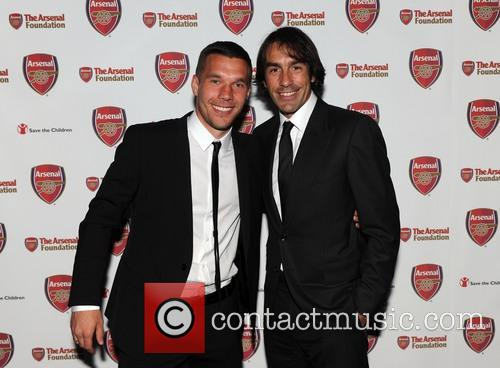 Lukas Podolski and Robert Pires 4