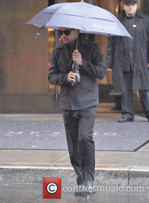 wilmer valderrama celebrities out during a rainy 3654456