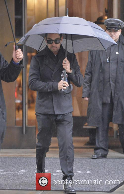 wilmer valderrama celebrities out during a rainy 3654459