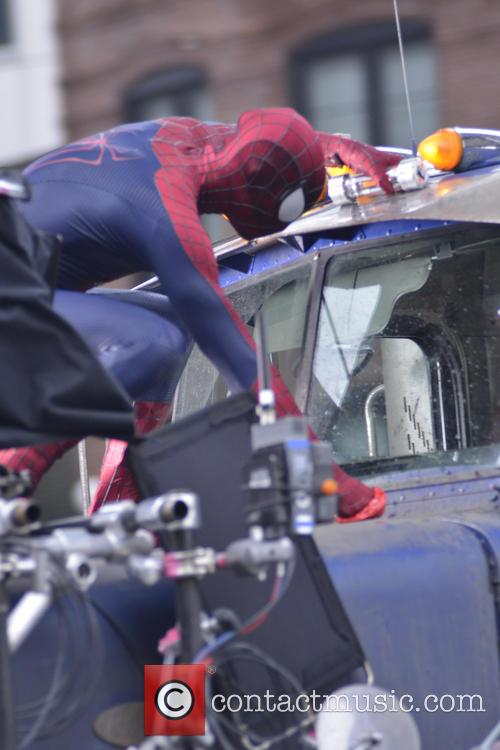 Andrew Garfield and Paul Giamatti filming an action...