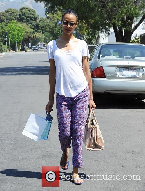 A casual looking Zoe Saldana is seen leaving...