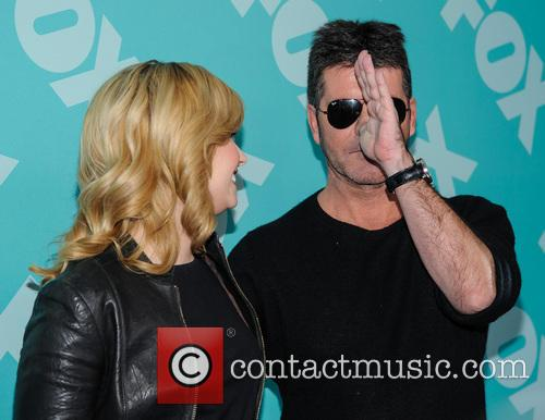 Demi Lovato and Simon Cowell 7