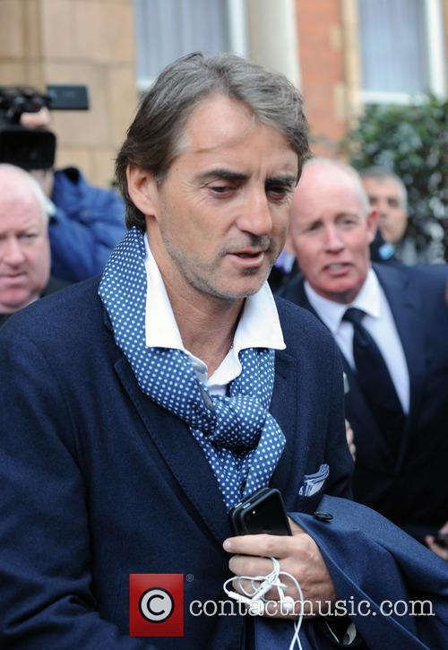 Sacked Manchester City manager, Roberto Mancini, seen leaving...