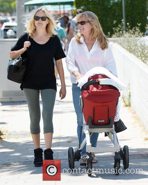 Malin Akerman and her mother take baby Sebastian...