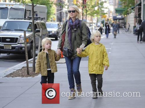Naomi Watts collects her children from school