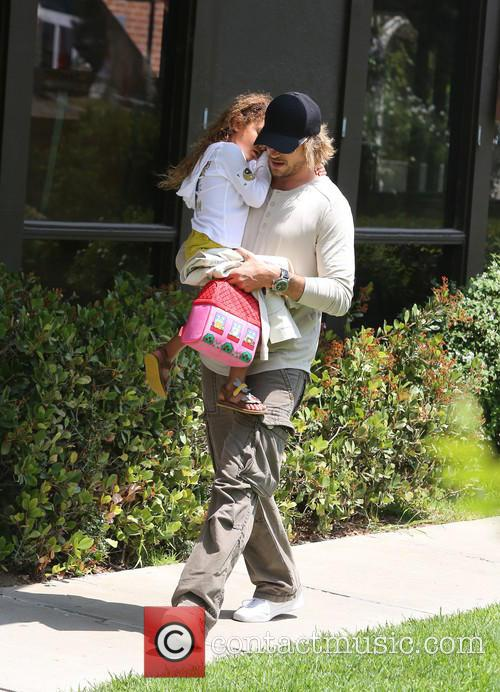 Gabriel Aubry collects daughter from school