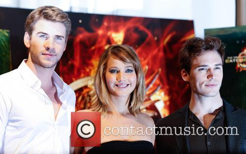 Liam Hemsworth, Jennifer Lawrence and Sam Claflin 11
