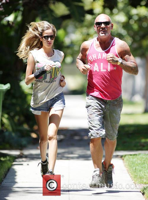 Christian Audigier and Nathalie Sorensen out jogging