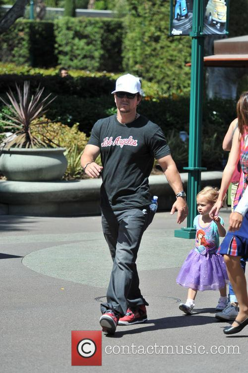 Mark Wahlberg and his wife take their daughter to disneyland