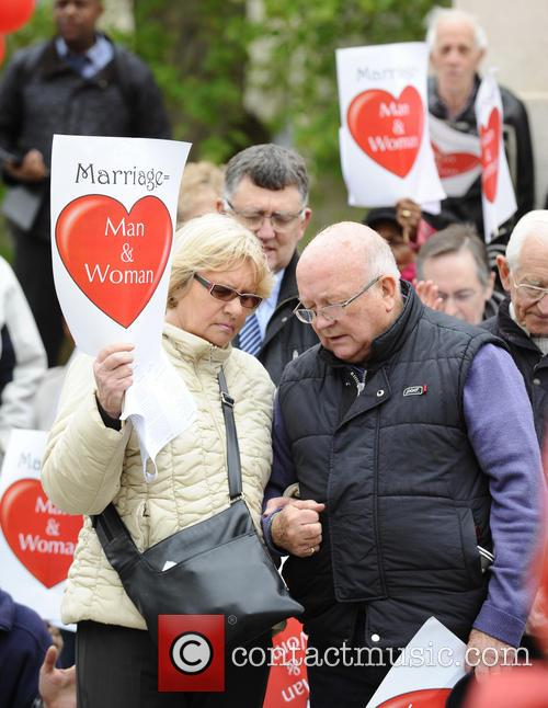 Christians protest homosexuals being allowed to marry outside...