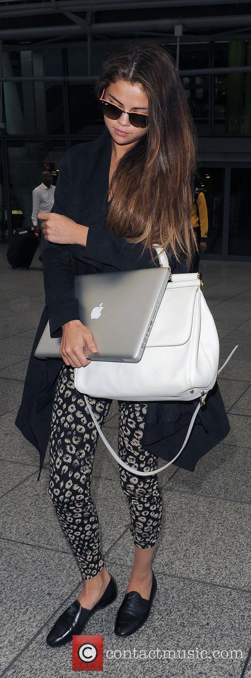 Selena Gomez arriving at Heathrow Airport