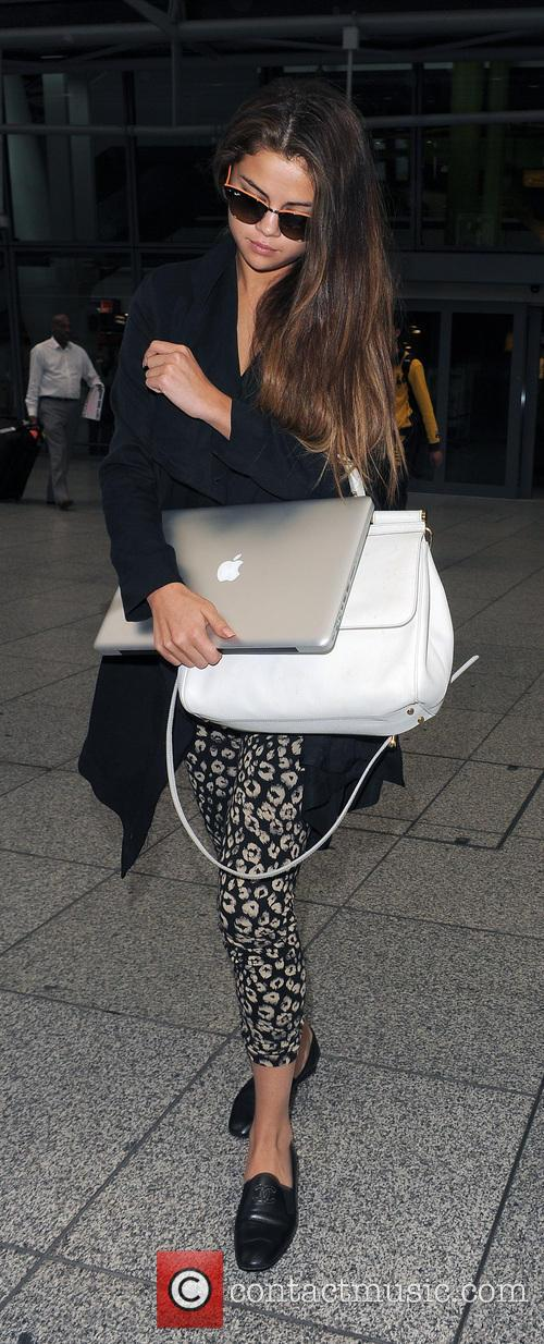 Selena Gomez arriving at Heathrow Airport