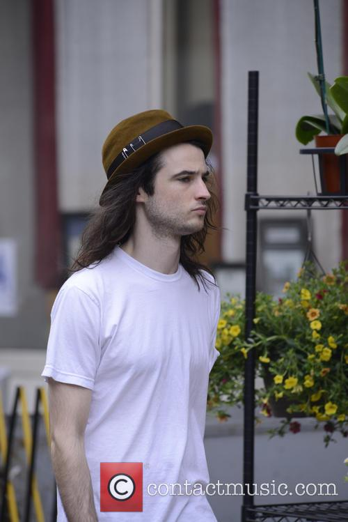 Tom Sturridge in Manhattan after walking with Andrew Garfield and his dog