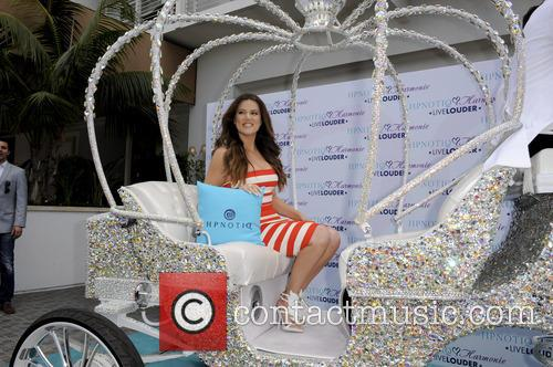 Khloe Kardashian Odom celebrates the launch of HPNOTIQ...
