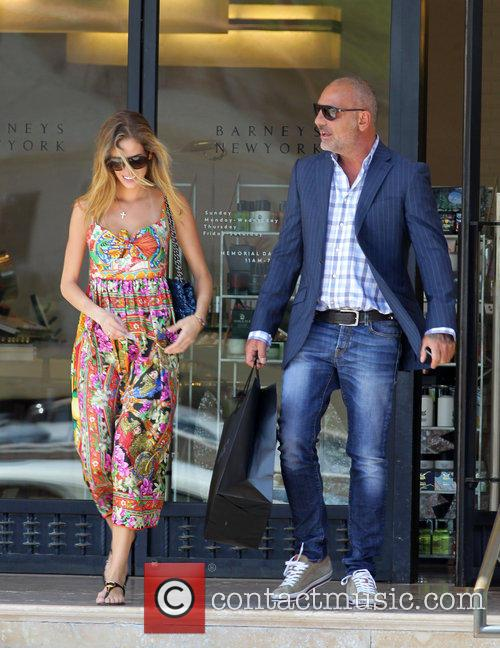 Christian Audigier and Nathalie Sorensen shop at Barney's