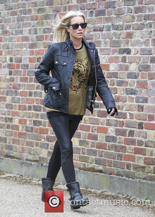 Denise van Outen goes for a walk alone...