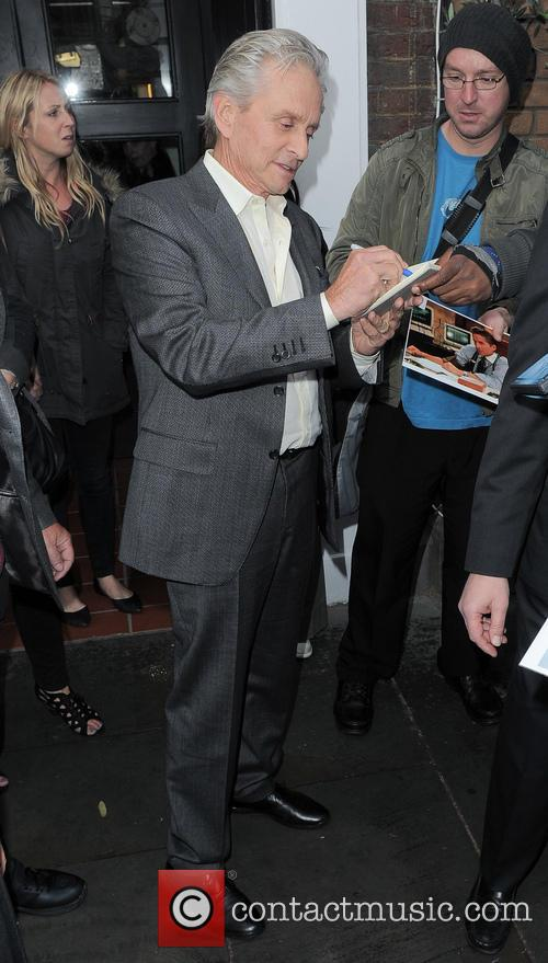 Michael Douglas signs autographs outside Claridge's hotel in...