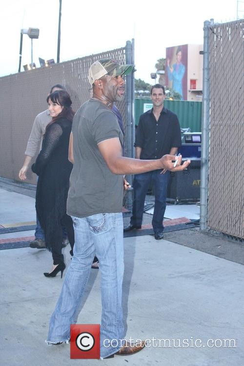 Darius Rucker signs autographs after his appearance on...