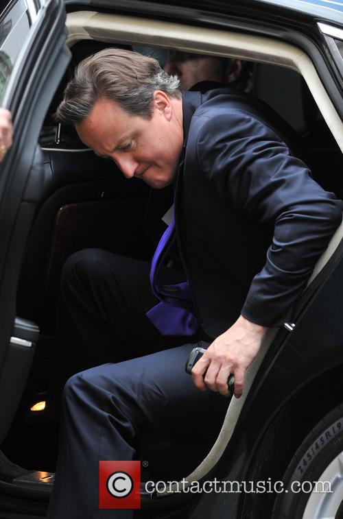 Prime Minister David Cameron returns to 10 Downing...
