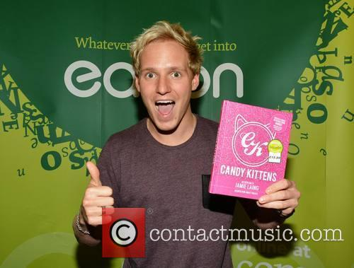 Jamie Laing signs his book 'Candy Kittens'