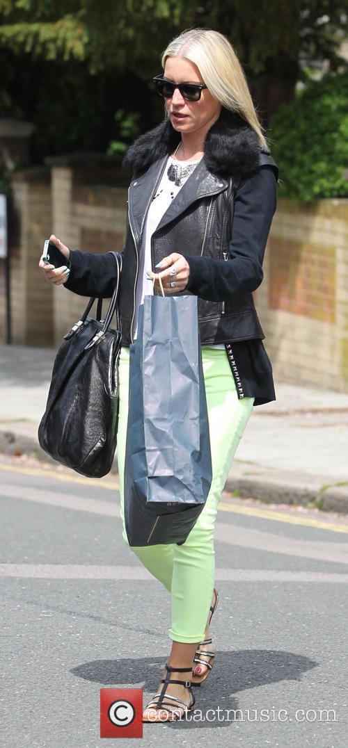 Denise Van Outen leaving her North London home