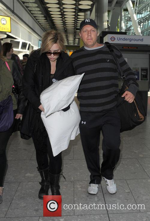 Demi Lovato arrives at Heathrow Airport on a flight from Los Angeles