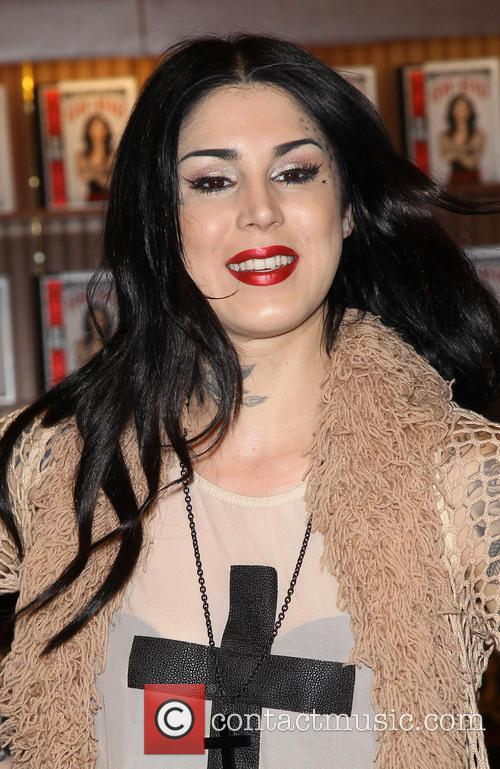 Kat Von D signs copies of her new...