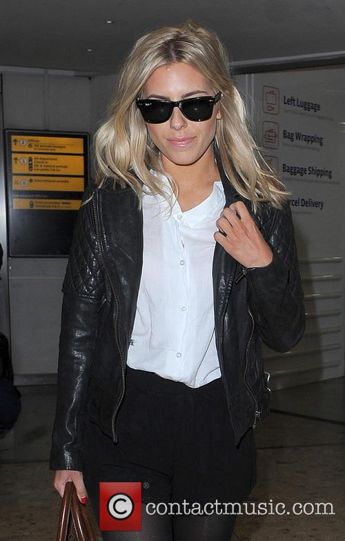 The Saturdays arriving at Heathrow Airport on a flight from Belfast