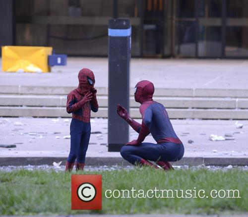 Spider Man talks to his smaller counterpart