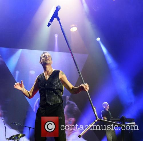 Dave Gahan performs a feat of strength with a mic stand at the O2, London
