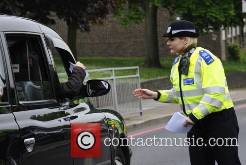 Police hand out flyers that appeal for information...